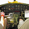 """Flight deck stations for Pilot (Aircraft Commander) and co-pilot. I doubt the orange and white """"driving"""" gloves were standard US Army Air Corps issue."""