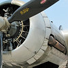 """Cowl flaps. They are open because on the ground and during climb the engines needed add'l """"flow through"""" ventilation for adequate cooling."""