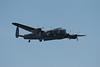 Avro Lancaster bomber flies past, bomb bays open.