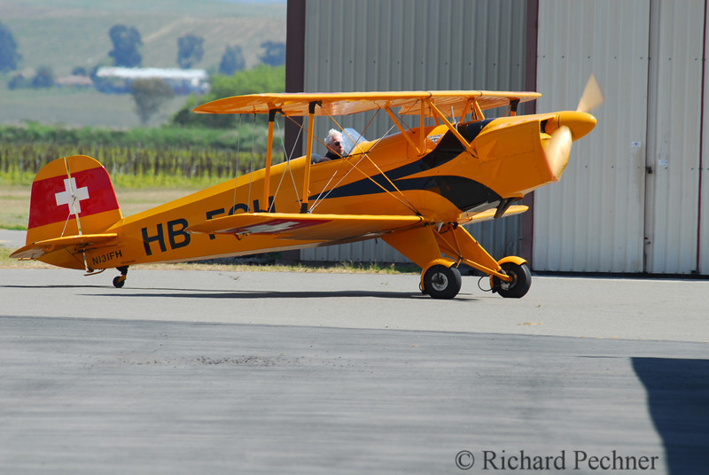 Swiss marked WWII German biplane trainer headed to hanger