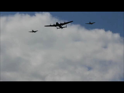 Lancaster and two spits fly overhead. Its not quite sharp, but this video is best for the sound - turn it up and hear those Merlin engines!
