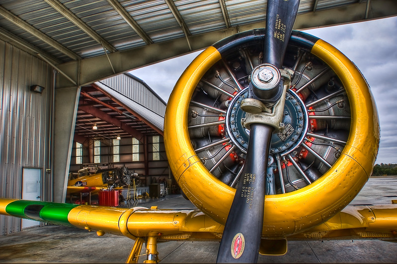 "The Hangar<br />    ~Texan 6~<br /> <br />    Military Trainer<br /> This Beautiful T-6 can be seen and flown at Warbird Adventures, Kissimmee, Florida<br /> <br /> Famed Photographer, author or over 40 books, Publisher and Editor, instructor, lecturer, and my biggest Photography Guru:  Scott Kelby, recently said about this photo:<br />          ""This shot! This shot is a badazz photo!  Great composition!  Tone mapping is on the money!  I wish I had taken this photo! It's that good.""<br /> <br /> Copyright Barb Cochran 2010 VA 1-746-637.  All rights reserved."