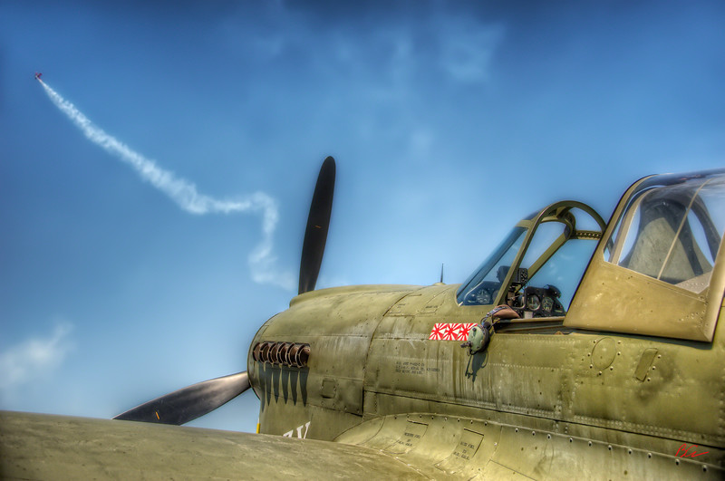 "~Watchin the Air Show~<br /> Curtis P-40 parked, ""As If"" watching the aerobatics performance overhead.<br /> <br /> Sun N Fun 2011"