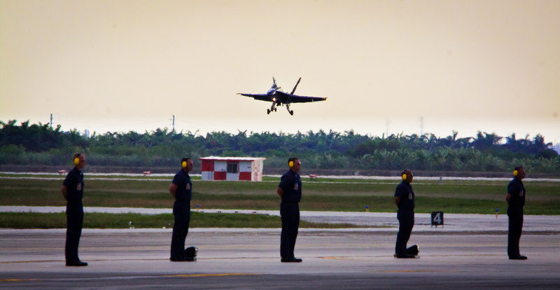 Blue Angel lands behind support crew