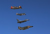 Four legends of U.S. fighter plane history did a fly-by. From top: P-47, P-51, F-16, F4 Phantom.