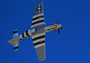 P-51 Mustang. The stripes are D-Day markings, and every Allied invasion aircraft had them. The purpose was to reduce chances of being shot down by friendly fire.