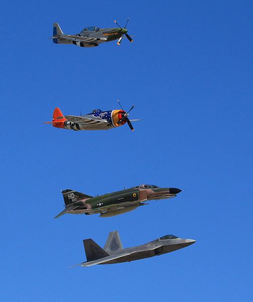 Legends of flight. From bottom up, Lockeed Martin/Boeing F-22 Raptor stealth fighter, McDonnell Douglas F4 Phantom, Republic P-47, North American P-51.