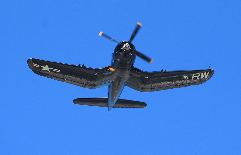 F4U Corsair. It carried multiple nicknames like Bent Wing Bird, Whispering Death, U-Bird, Hog Nose, and Ensign Eliminator. The long nose was needed to (1) get the large propeller away from the ground and (2) hold an auxiliary fuel tank in the best balance spot, in front of the pilot. Adding that much fuel to the wing tanks would have hurt agility and increased the risk of getting into an unrecoverable spin due to centrifugal forces.