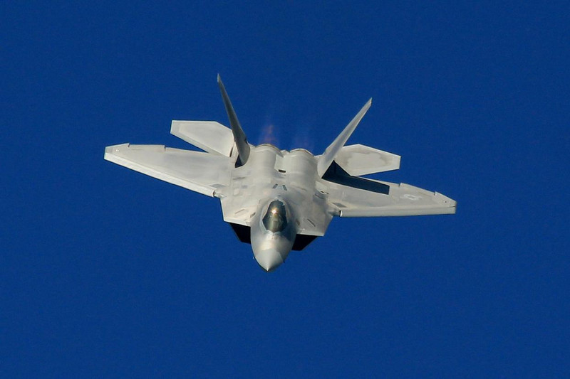 F-22 Raptor coming out of a dive right at us. The first run of F-22's was 187 airframes. They had a total cost of $67.3 billion based on public information totals, or about $359 million each. The Pentagon says the first 187 only costs $137 million each. Don't you love governmental math?