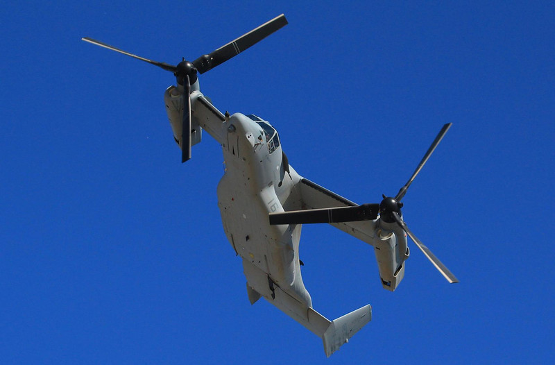 "A V-22 Osprey shown here in high speed ""plane mode"". It can vertically lift 40 combat ready troops and fly them at 300MPH to an engagement, then set down vertically in the field. Air blasters in the nacelles divert the dust cloud from a desert landing away from the landing area so the troops can see during the disembarkation. Early accidents plagued the design but no unusual incidents have occurred during the last 10 years and field performance has been great."