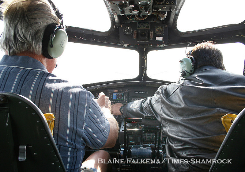 BLAINE FALKENA/Staff Photographer<br /> Pilot Mac McCauley, left, and Fred Lewis fly a B-17 Flying Fortress from Binghamton, New York to Hazleton Municipal Airport Wednesday afternoon as part of the Collings Foundation Wings of Freedom flying museum.