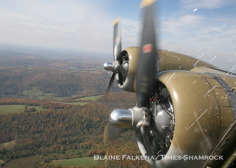 BLAINE FALKENA/Staff Photographer<br /> Propeller blades spin on two of the engines of a B-17 Flying Fortress Wednesday afternoon on the way to Hazleton Municipal Airport from Binghamton, New York.