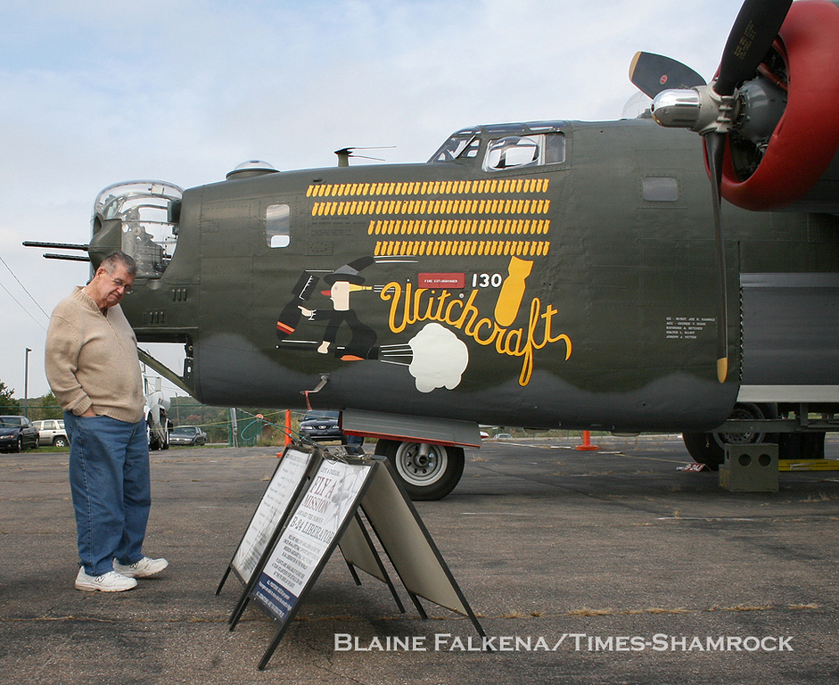 BLAINE FALKENA/Staff Photographer<br /> Walter Woods, a World War II veteran, looks at the signs placed in front of a B-24 Liberator Wednesday afternoon at Hazleton Municipal Airport. The plane and three other vintage aircraft - a B-17, a B-25, and a P-51 - were at the airport as part of the Collings Foundation's Wings of Freedom Tour flying museum. Woods flew 28 missions in the Eighth Air Force's 486th Bomb Group, 834 Squadron as a ball turret gunner; 12 in a B-24 and 16 in a B-17 during 1944-45.