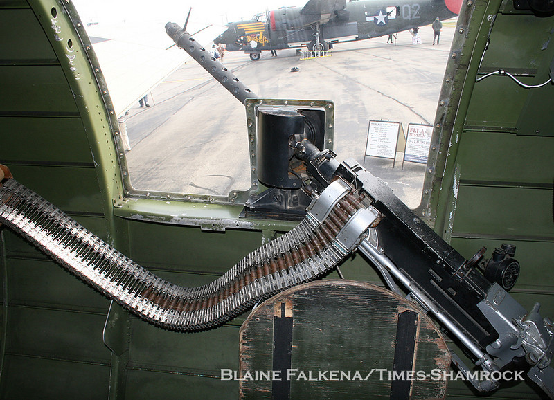 BLAINE FALKENA/Staff Photographer<br /> The Collings Foundation's B-24 can be seen out the waist gunner's window of their B-17 with the .50 caliber machine gun in the foreground.