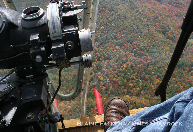 BLAINE FALKENA/Staff Photographer<br /> The view from the bombadier station on board a B-17 Flying Fortress is awe-inspiring, as if you are just sitting in a chair out in the sky, with almost a 180-degree feild of vision. Here the bright autumn colors of the trees are clearly visible through the plexiglas nose cone.
