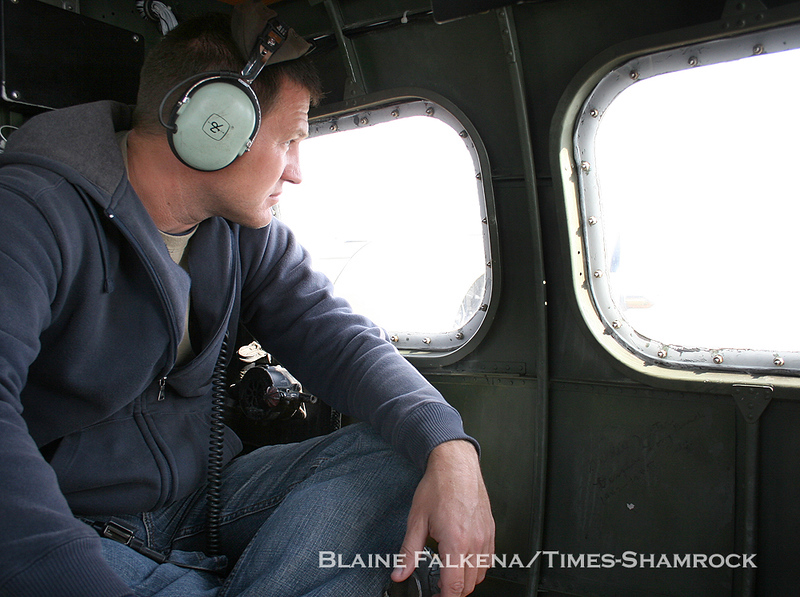 BLAINE FALKENA/Staff Photographer<br /> Flight engineer Rick Ziel looks out the window of the Nine-O-Nine B-17 Flying Fortress on the way from Binghamton, New York to Hazleton Municipal Airport Wednesday afternoon.