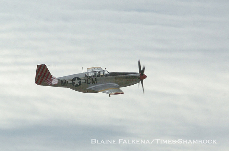 BLAINE FALKENA/Staff Photographer<br /> A P-51 Mustang does a fly-by before landing in Binghamton, New York before continuing on to Hazleton Municipal Airport Wednesday as part of the Wings of Freedom flying museum.