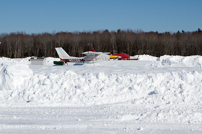 When I arrived the taxiway was plowed but the ramp was not.  The snow was all hard packed drifts. - Copyright (c) 2013 Daniel Noe