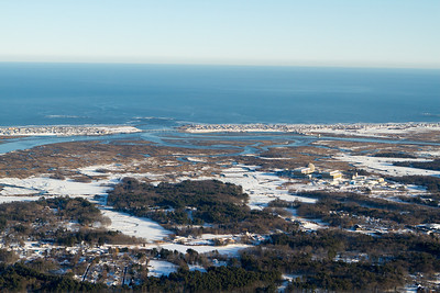 Newburyport.  Wave action seems to have inhibited snow cover in the marshy areas closes to the inlet. - Copyright (c) 2013 Daniel Noe