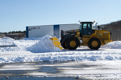 Finally the airport snow clearing crew came by with big loaders to clear this section of the ramp. - Copyright (c) 2013 Daniel Noe