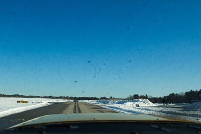 Taxiway alpha was nicely cleared.  The sunlight on the pavement melted things as soon as the black was exposed.  My windshield has some leftover deicing fluid (water/glycol) drops.  Next time I will have to make sure to wipe the windshield after. - Copyright (c) 2013 Daniel Noe