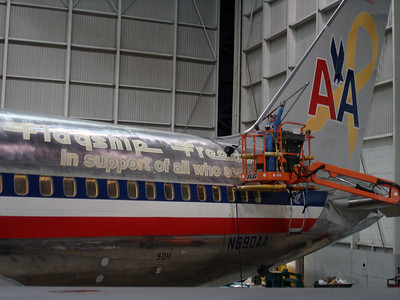 The metal has been stripped, sticker applied, and masked off. now buffing of the airplane