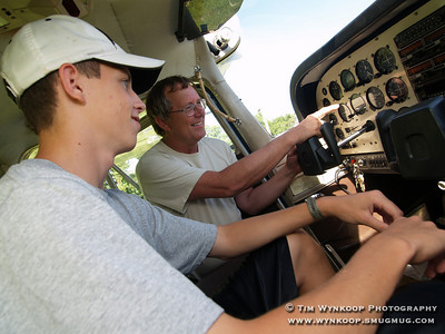 Forks Township, Pa, 08-12-2007: Pilot Ed Deacon introduces 16-year-old Jeffrey Evanko, of Nazareth, to some of the flight controls in his airplane. Jeffrey became the 2000th Young Eagle at the Experimental Aircraft Association, Chapter 70's, Young Eagle Day at Braden Airpark in Forks Township Sunday. To learn more about Young Eagles, visit http://www.youngeagles.org. (Photo by: Tim Wynkoop)