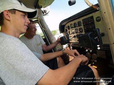 Forks Township, Pa, 08-12-2007: Pilot Ed Deacon introduces 16-year-old Jeffrey Evanko, of Nazareth, to some of the flight controls in his airplane. Jeffrey became the 2000th Young Eagle at the Experimental Aircraft Association, Chapter 70's, Young Eagle Day at Braden Airpark in Forks Township Sunday. To learn more about Young Eagles, visit www.youngeagles.org. (Photo by: Tim Wynkoop)