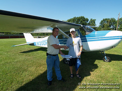 Forks Township, Pa, 08-12-2007: 16-year-old Jeffrey Evanko, of Nazareth, poses with pilot Ed Deacon, after becoming the 2000th Young Eagle at Braden Airpark Sunday morning, during the Experimental Aircraft Association, Chapter 70's, Young Eagle Program. Jeffrey was award a certificate of his flight, a free introductory flight from Moyer Aviation and a host of other prizes. The Young Eagle's program, which began in 1992, gives children between the ages of 8 and 17 a free ride in an airplane to introduce them to aviation. To learn more about Young Eagles, visit http://www.youngeagles.org. (Photo by: Tim Wynkoop)