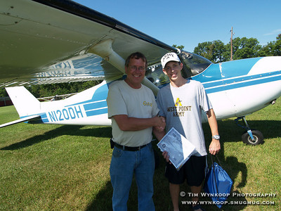 Forks Township, Pa, 08-12-2007: 16-year-old Jeffrey Evanko, of Nazareth, poses with pilot Ed Deacon, after becoming the 2000th Young Eagle at Braden Airpark Sunday morning, during the Experimental Aircraft Association, Chapter 70's, Young Eagle Program. Jeffrey was award a certificate of his flight, a free introductory flight from Moyer Aviation and a host of other prizes. The Young Eagle's program, which began in 1992, gives children between the ages of 8 and 17 a free ride in an airplane to introduce them to aviation. To learn more about Young Eagles, visit www.youngeagles.org. (Photo by: Tim Wynkoop)