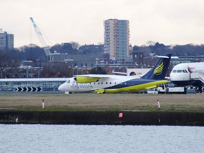 HB-AER London City Airport 1st February 2013 On taxi for departure.