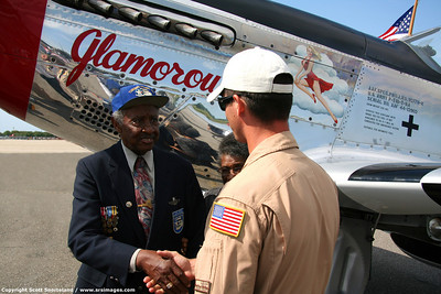 Chris Baranaskas shakes hands with retired Tuskegee airman Lt. Col. Floyd J. Carter.