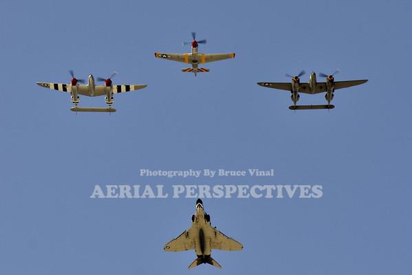 "NL7723C - 1944 Lockheed P-38L ""Honey Bunny""   NX138AM - 1943 Lockheed P-38J ""23 Skidoo""   NL351MX - 1944 North American P-51D ""February""   Air Combat Command Heritage Flight's F-4 Phantom II"