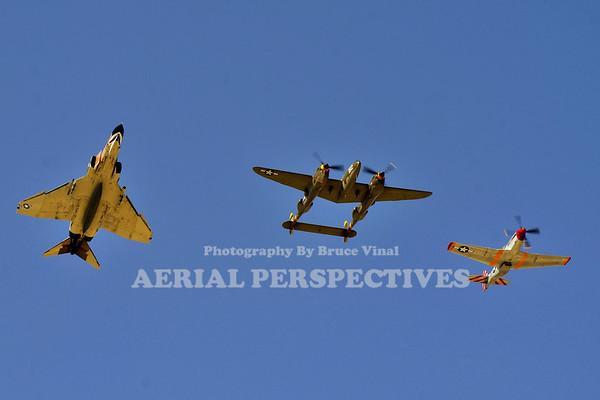 "NX138AM - 1943 Lockheed P-38J ""23 Skidoo""   NL351MX - 1944 North American P-51D ""February""   Air Combat Command Heritage Flight's F-4 Phantom II"