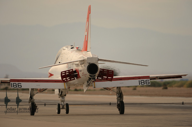 Air Brakes extended, the T-45 Goshawk rolls down the runway