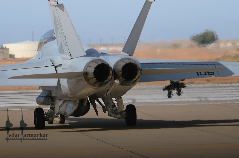 """The """"backend"""" of the F/A-18F Rhino, holding short of the runway, in preparation for takeoff"""