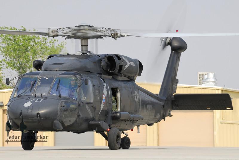 HH-60 Blackhawk of NSAWC on the ramp prepare to takeoff