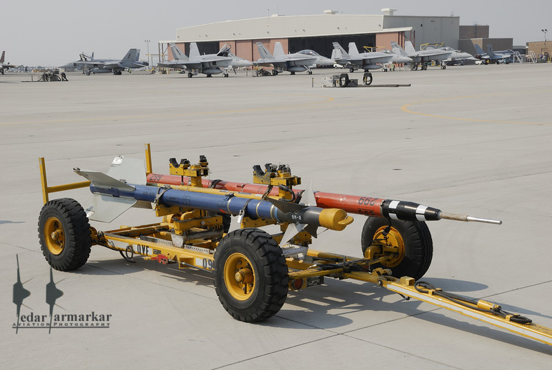 AIM-9 Sidewinder and the ACMI Telemetry pods carried by aircraft for combat simulation