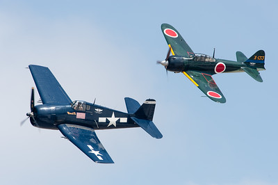 "Naval Base Ventura County (NBVC Point Mugu) 2010 Air Show. SoCal CAF Grumman F6F-5 Hellcat & Mitsubishi A6M3 Type 0 Model 22 ""Zero"" in close formation flying"