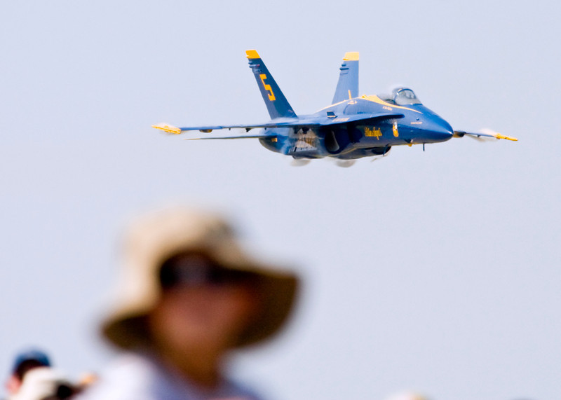 Blue Angel High Speed Sneak Pass<br /> <br /> Poor kid almost crapped his pants a few moments later as the FA-18 flown by the Lead Solo blew past at nearly Mach 1. This is the moment where he is still young and innocent before Navy treachery ages him before his time.