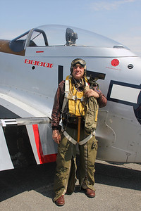 WWII gunner re-enactor in front of a P-51 Mustang
