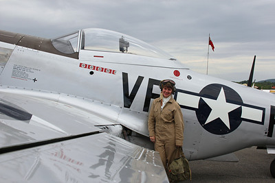 WASP re-enactor in front of a P-51 Mustang