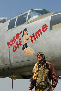 Bomber gunner re-enactor in front B-25 Mitchel Bomber