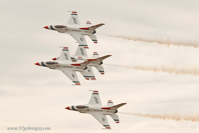 Thunderclouds, white clouds, smoke -- all combined to make proper exposure a real challenge during the T-birds routine.