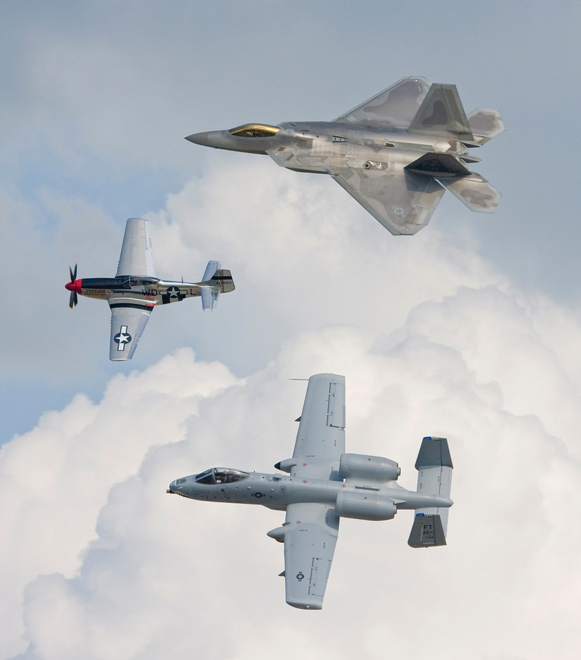 USAF Heritage Flight - F-22 Raptor on top, P-51D in the lead, A-10 Thunderbolt II (the Warthog) on bottom. This is the last of the Andrews Joint Services Open House 2009 that I'll be showing in the dailies. Upcoming:  the Patuxent River NAS Air Show pics I took yesterday :)