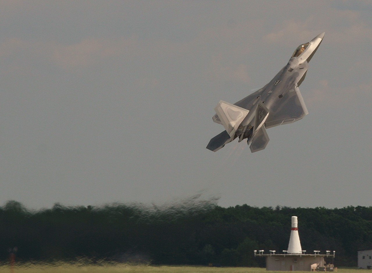 F-22 Raptor on Takeoff.<br /> <br /> This airshow was the first time the new fighter flew a full public demonstration. The things it can do are awesome. It's agility and maneuverability rival the unlimited class aerobatic planes. And it looks very cool :)