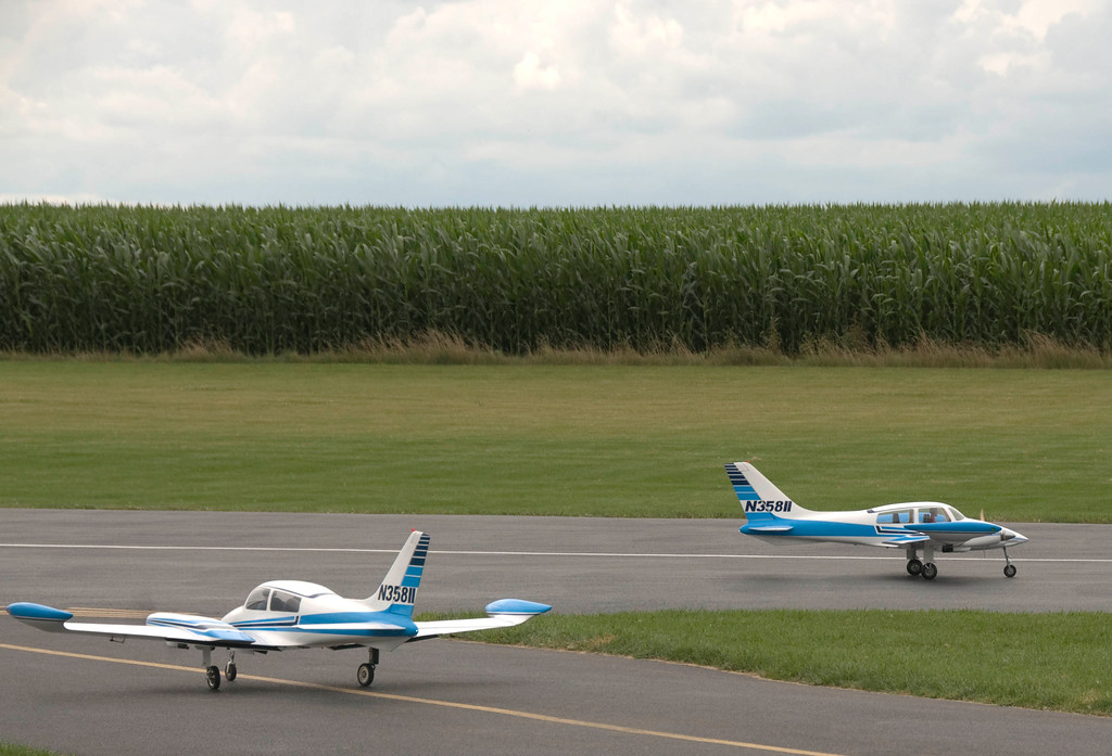Hey.....something's fishy here.  Both of these Cessna 310s have the same N number!!!  lol!<br /> <br /> DuPage County R/C Large Scale Air Show - July 19, 2009