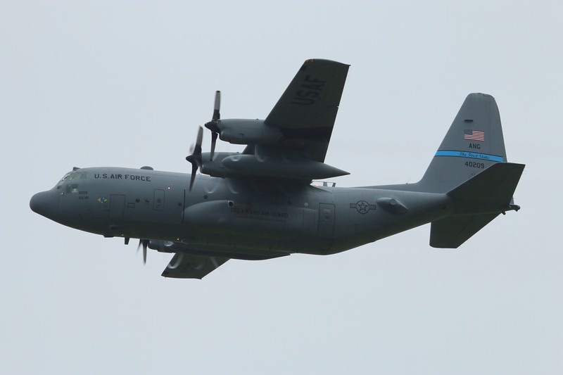 HUSKY01 Delaware ANG C-130H [84-0209] departing rwy 6 in the rain Friday