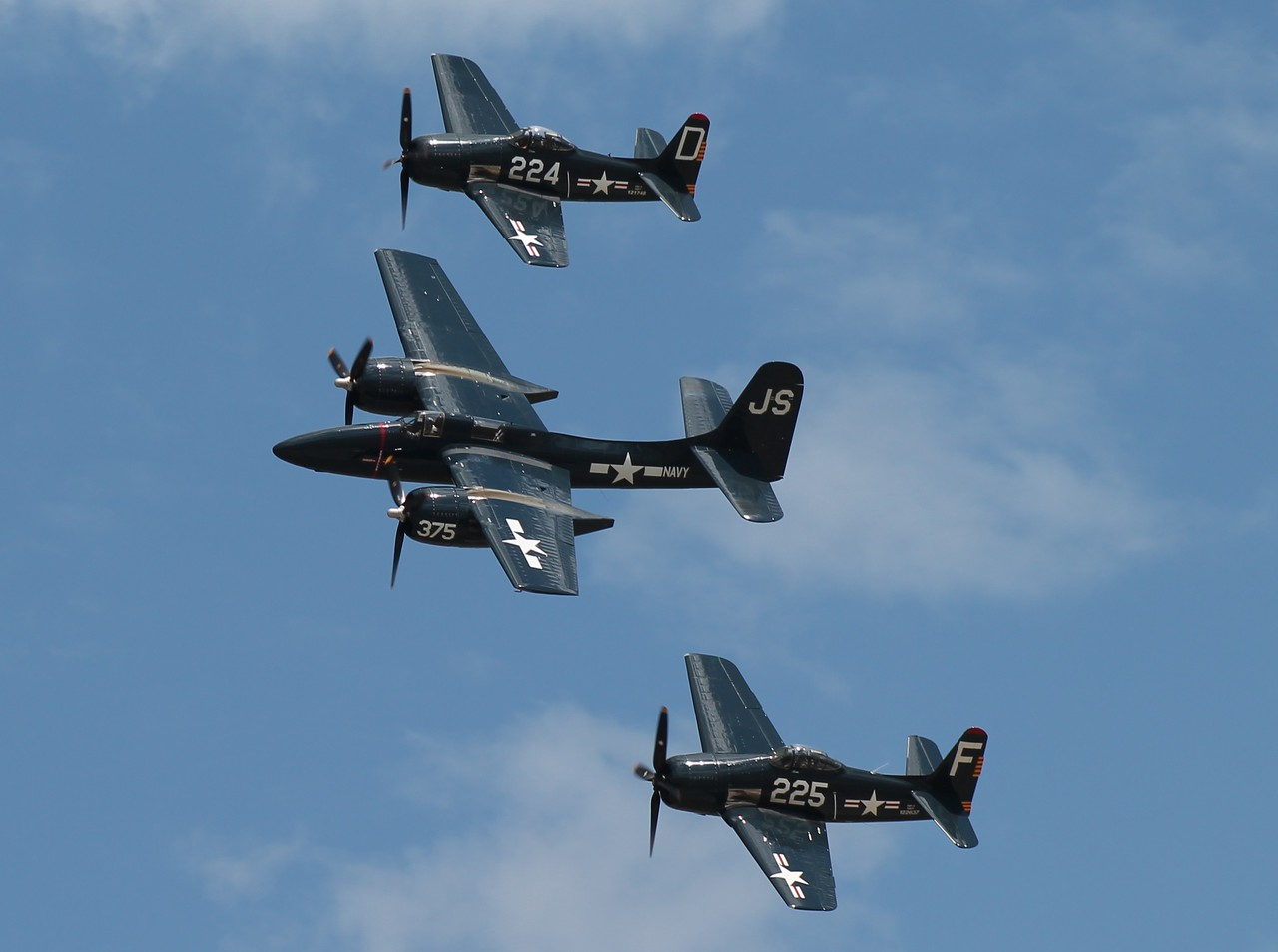 Two F8F Bearcats and an F7F Tigercat.