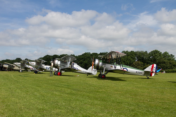 Line up of biplanes